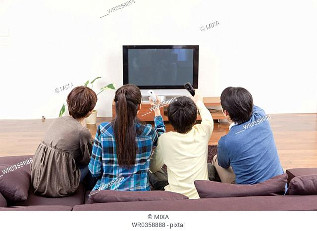 Family Playing Video Game Together
