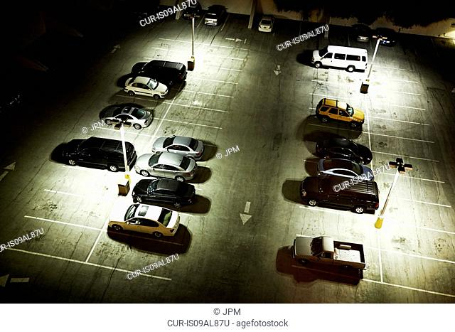 High angle view of cars in parking lot at night