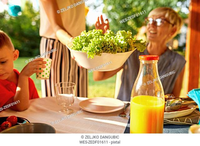 Woman serving salad on a garden party
