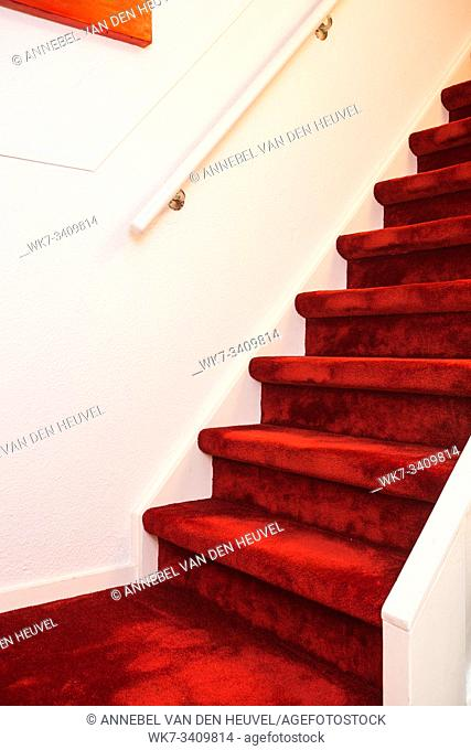 Modern Indoor Marble Staircase With Red Carpet and white wall