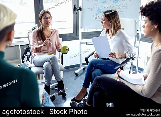 Businesswomen during meeting at a flipchart