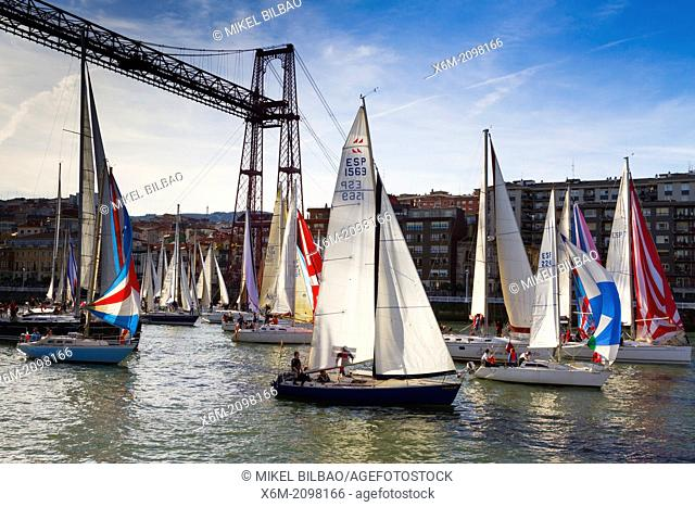 Gallo boat race and Vizcaya bridge. Mouth of Nervion river. Portugalete, Biscay, Basque Country, Spain