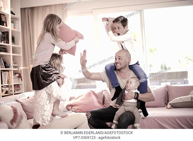 family fighting on couch
