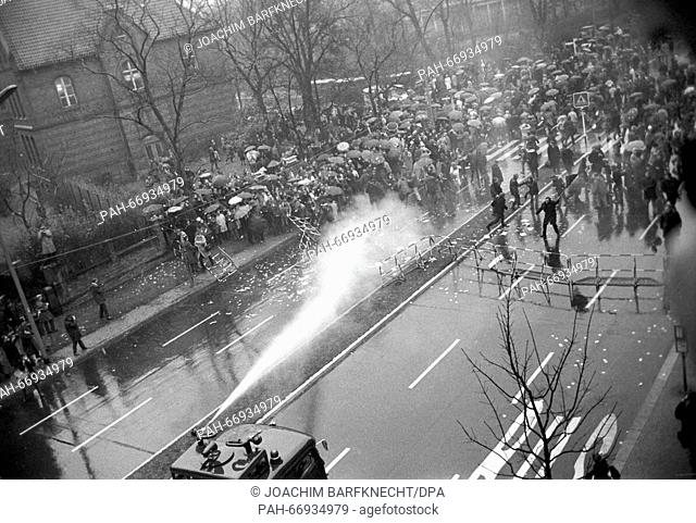 The police uses water guns against demonstrators, who demand Fritz Teufel's release on 27 November 1967. - Berlin/Germany