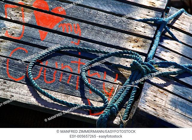Ireland series in detail. weathered planks with blue rope and painted heart with saying: I love my country