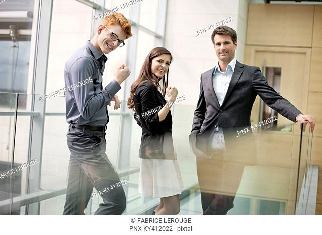 Business executives cheering up in an office