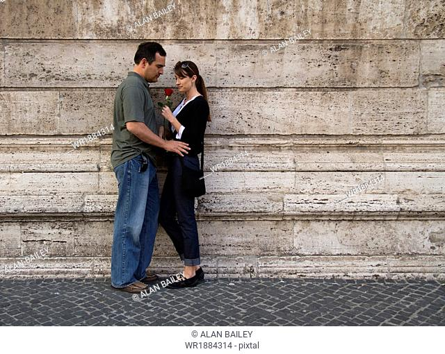 Italy, Rome, Vatican City, Romantic couple standing at wall