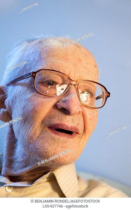 A senior man smiling