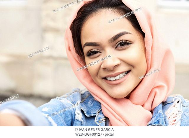 Self-portrait of young woman wearing hijab