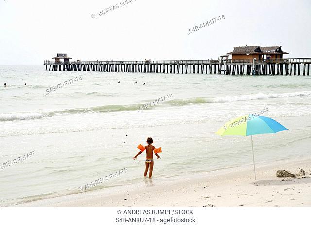 Child on the beach, Naples, Florida, USA