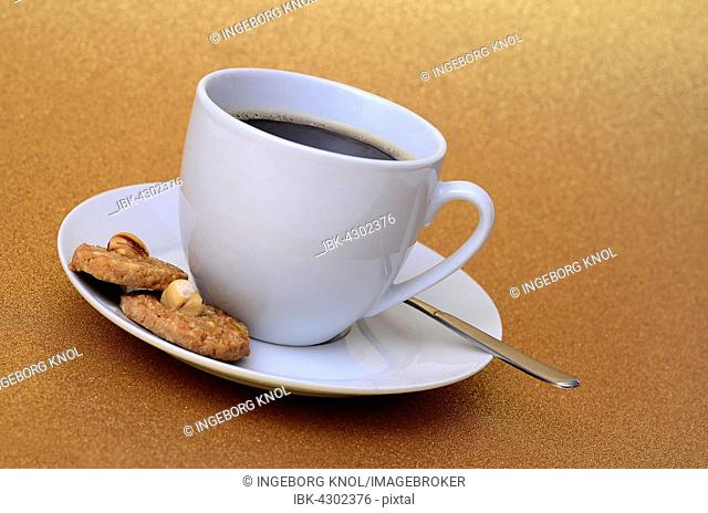 White coffee mug, coffee and biscuits