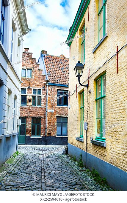 Narrow cobbled stone street of Patershol, Ghent, Belgium