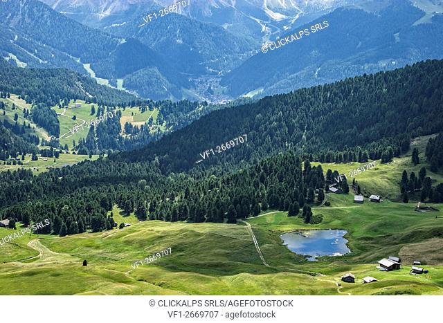 Aerial view of Lech Sant (lake Saint) and chalets, Seceda, Odle mountain range, Dolomites, Sudtirol, Italy