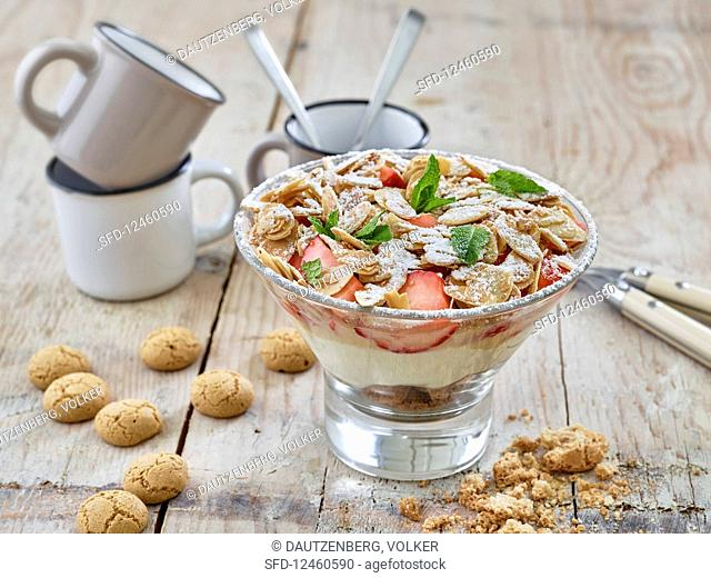 A layered dessert with strawberries, egg liqueur mascarpone and amarettini