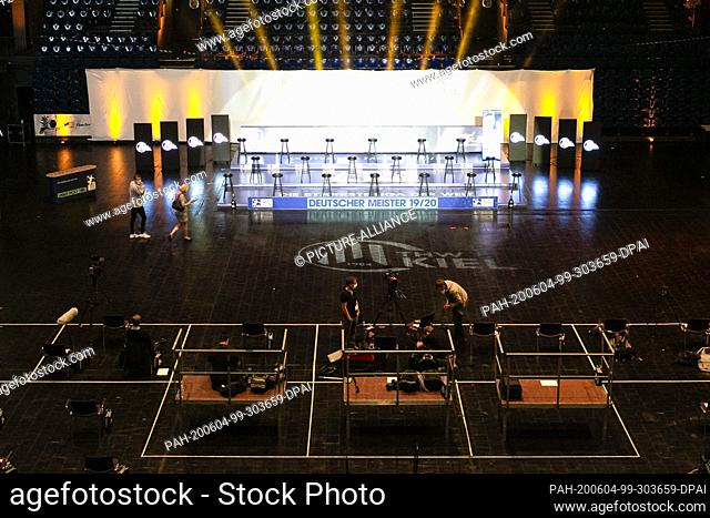 04 June 2020, Schleswig-Holstein, Kiel: Bar stools for the players of THW Kiel are placed at a distance from each other on a stage in Kiel's Sparkassen-Arena...