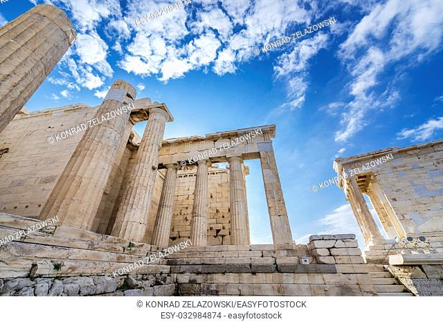 Monumental gateway called Propylaea, entrance to the top of Acropolis of Athens city, Greece. Temple of Athena Nike on right