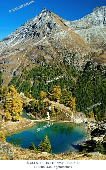 Lake Blausee or Lac Bleu, Petite Dent de Veisivi mountain at the back, Val d'Hérens valley, Arolla, Canton of Valais, Switzerland