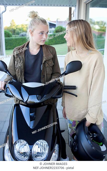 Teenage girls with scooter