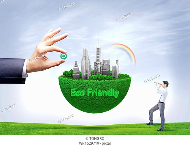a business man looking at a eco friendly city