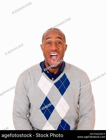 A tall handsome African American man standing screaming with his mouth open, isolated for white background