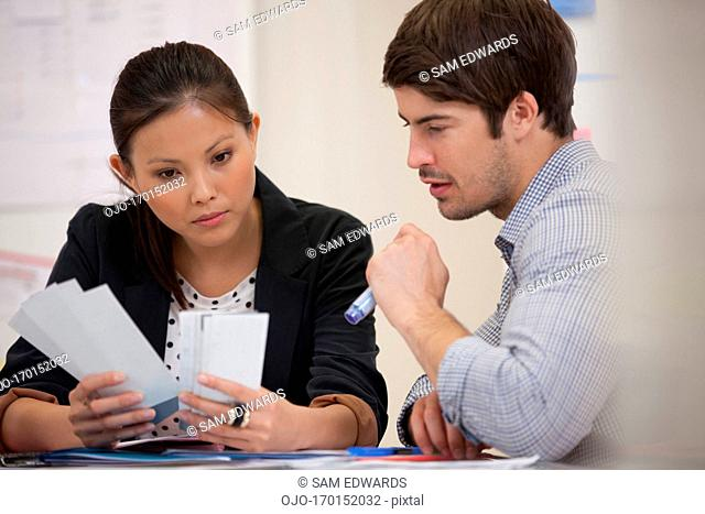 Businessman and businesswoman talking in meeting