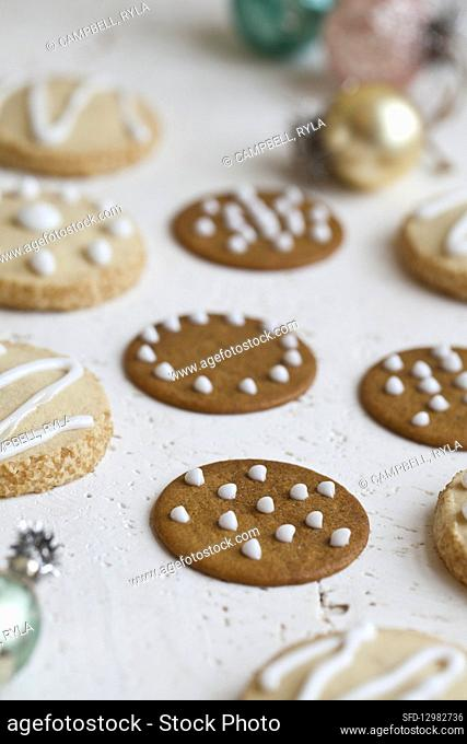 Ginger cookies with white icing and holiday ornaments