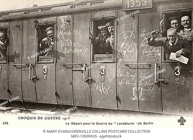 German soldiers on a train on their way to the front in Germany. On the train are inscribed messages showing enthusiasm of the departing soldiers