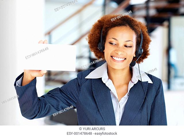Happy African customer service executive showing blank card