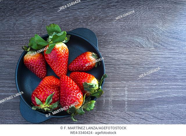 Small pan with strawberries