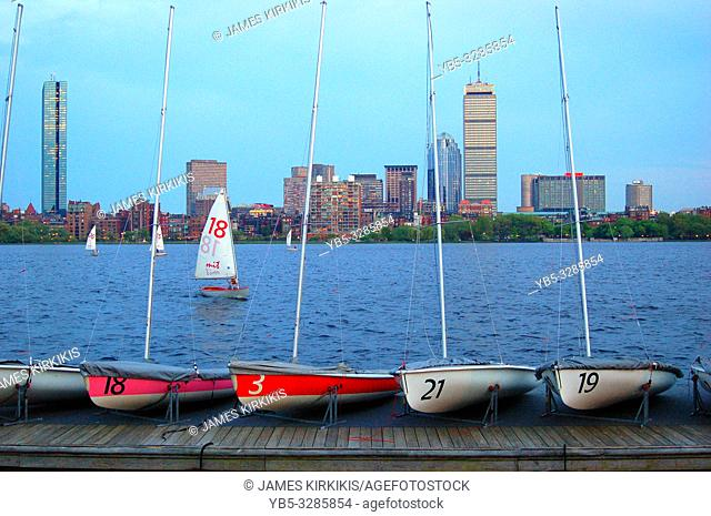 Small sailboats of MIT sit across the river from Boston