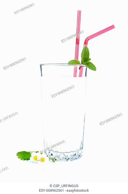 in a glass of milk and flowers on an isolated white background