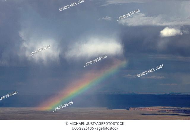 A rainbow appears during a thunderstorm at Marble Canyon at Grand Canyon National Park, Arizona