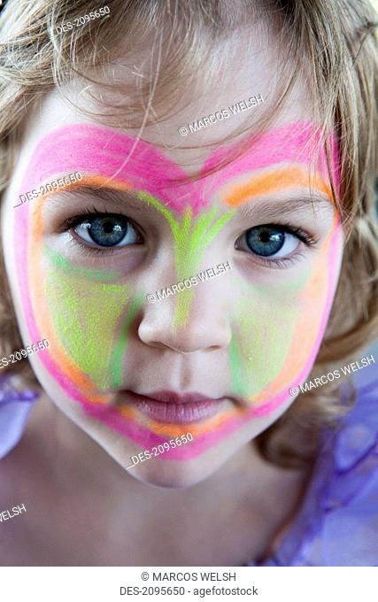 A young girl with her face painted, gold coast queensland australia