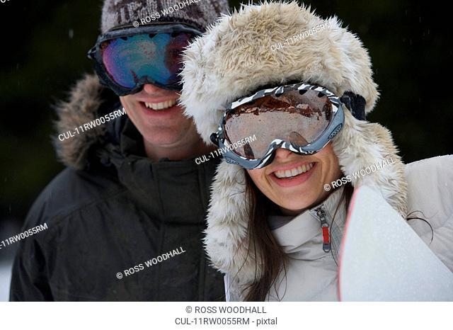 Portrait of a snowboarding couple