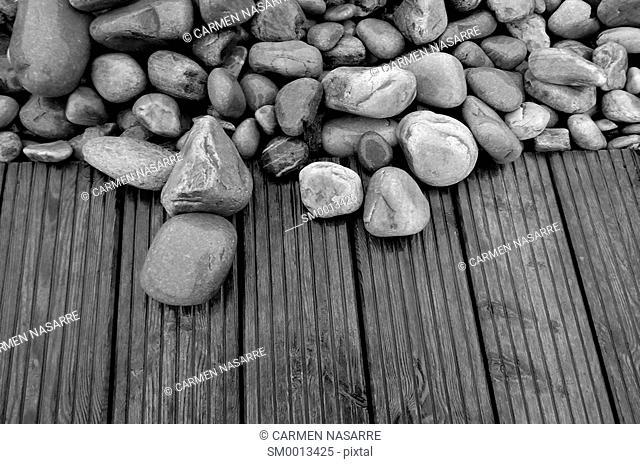 Boulders and wooden walkway on the beach Concha de Artedo, Asturias
