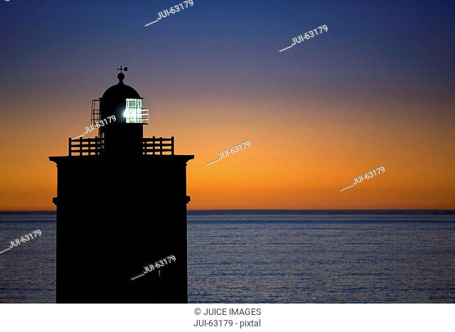Scenic view of lighthouse at sunset
