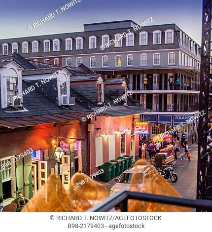 View of the French Quarter from at twilight from the balcony of Maison de Ville Hotel on the corner of Bourbon and Toulouse Streets