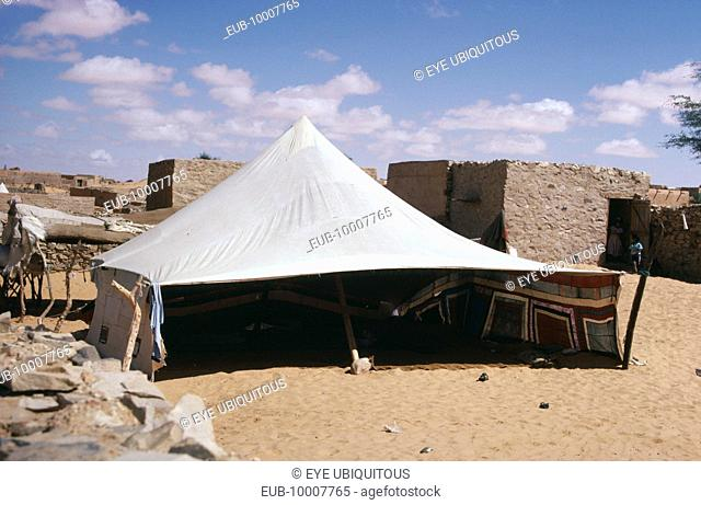 Tent pitched near old buildings