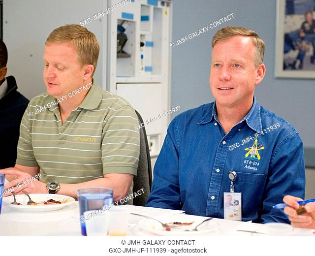 NASA astronauts Steve Lindsey (right), STS-133 commander; and Eric Boe, pilot, are pictured during a food tasting session in the Habitability and Environmental...