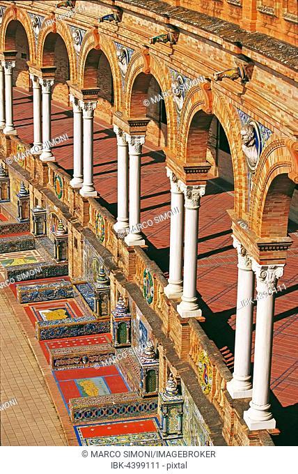 Arcades and decorative tiles, Plaza de España, Seville, Andalusia, Spain