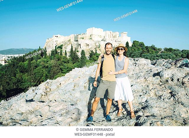 Greece, Athens, happy couple with The Acropolis in the background
