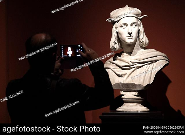 """04 June 2020, Saxony, Dresden: A man takes photographs during a press tour in the exhibition """"""""Raphael - Power of Images"""