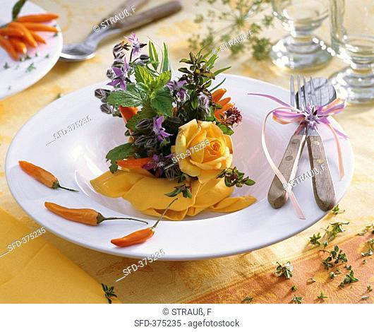 Small arrangement of roses and herbs plate decoration