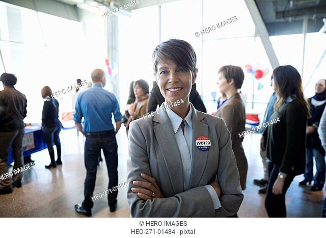 Portrait confident businesswoman at voter polling place