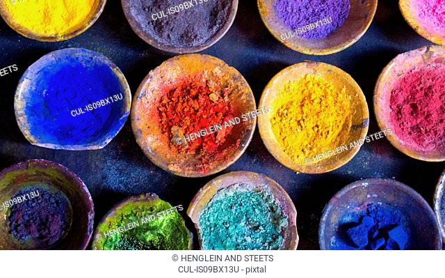 Vibrant pigment powder in clay dishes