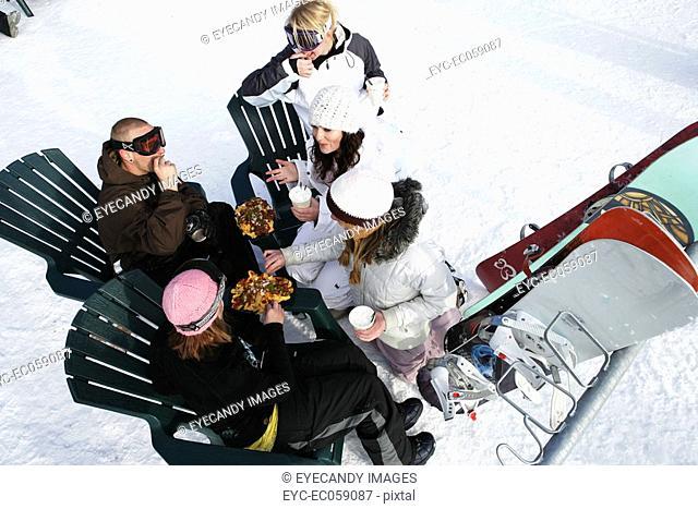 Group of friends enjoying hot drinkis