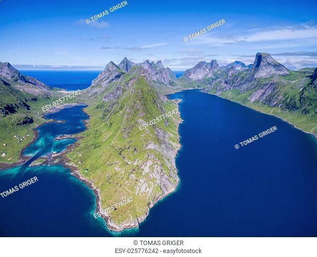Reinefjorden, beautiful fjord on Lofoten islands in Norway surrounded by magnificient peaks