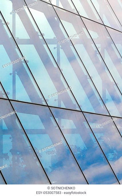 Architecture abstract background. Glass curtain walls. Fasteners elements of spider glass system. Facade detail