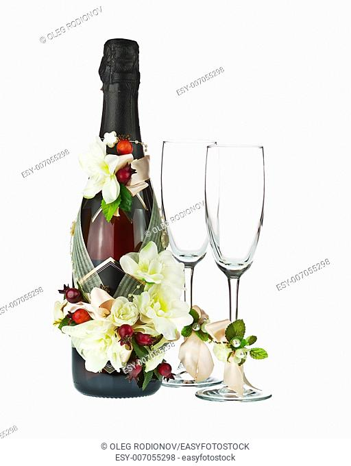 Champagne Bottle and Glass with Wedding Decoration of Flower Arrangements Isolated on White Background