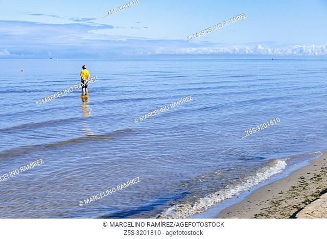 A woman on the seashore. Beach in Jurmala at the beginning of September. Jurmala, Latvia, Baltic states, Europe